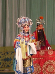 The Japanese performance art Noh is similar in many ways to Kathakali, and deploys numerous masks (above) and costumes. Peking opera of China (right).