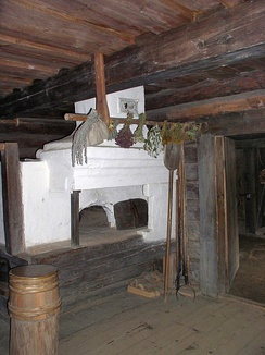 Typical Russian oven in a peasant izba.