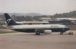 The historical AirAsia livery colour scheme in the 1990s, showing a blue and green cheatline with a white eagle logo.