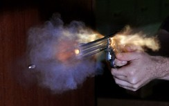 A photo of a Smith & Wesson Model 686  firing, taken with a high speed air-gap flash. The photo was taken in a darkened room, with camera's shutter open and the flash was triggered by the sound of the shot using a microphone.
