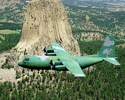 Lockheed C-130B Hercules 58-0714 flying past Devils Tower National Monument.