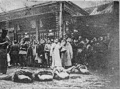 Ranked beheaded bodies on the ground, in Caishikou, Beijing, China, 1905