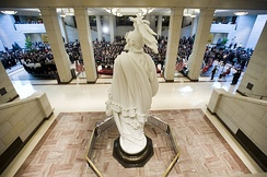 The opening ceremony of the Capitol Visitor Center in December 2008. The plaster cast model of the Statue of Freedom is in the foreground.