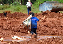 Child labour in Brazil, leaving after collecting recyclables from a landfill.
