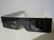 Eclipse glasses filter out eye damaging radiation, allowing direct viewing of the Sun during all partial eclipse phases; they are not used during totality, when the Sun is completely eclipsed