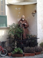 A sculpture of Padre Pio in a garden in Naples