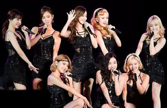 Girls' Generation. Left to right, standing: Sunny, Yuri, Yoona, Seohyun and Taeyeon. Left to right, kneeling: Sooyoung, Tiffany and Hyoyeon