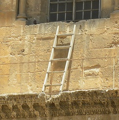 The Immovable Ladder. Detail from photograph of the façade of the main door to the Church of the Holy Sepulchre, Jerusalem, 2011.