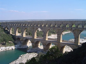 Pont du Gard in France is a Roman aqueduct built in c. 19 BC. It is a World Heritage Site.