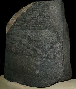 The Rosetta Stone, with writing in three different scripts, was instrumental in deciphering Ancient Egyptian.