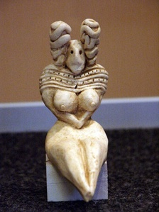 Female figure from Mehrgarh; 5500-2400 BCE; terracotta; height: 9.5 cm (3​3⁄4 in). Part of the Neolithic 'Venus figurines' tradition, this figure's abundant breasts and hips suggest links to fertility and procreation. Her hair was probably painted black; brown ochre would have convered the body, and her necklace was probably yellow. Her seated posture, with arms crossed under the breasts, is common throughout the region, as is her extravagant hairstyle
