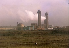 The two chimney stacks of the Windscale reactors, with the visible swellings to house Cockcroft's filters