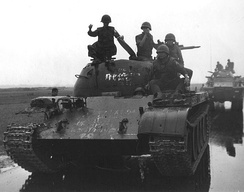 ARVN soldiers posing on top of a Type 59 tank