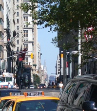 A view up Broadway from Bowling Green, with the Chrysler Building visible in the background