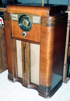 "During the ""Golden Age of Radio"" (1920 to 1950), families gathered to listen to the home radio in the evening, such as this Zenith console model 12-S-568 from 1938, a 12 tube superheterodyne with pushbutton tuning and 12 inch cone speaker."