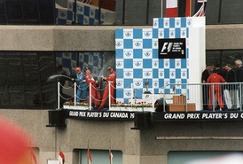Fisichella, Schumacher, and Irvine on the podium after the race.
