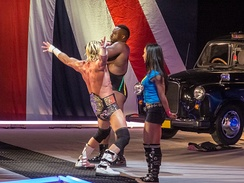 Ziggler as World Heavyweight Championship making his entrance with AJ Lee and Big E Langston