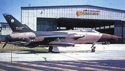 "Republic F-105B AF Serial No. 57-5829. The sign on the hangar proudly proclaiming McGuire AFB as the ""Home of the Air Guard Thunderchiefs""."