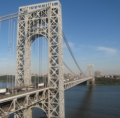 The George Washington Bridge, connecting Upper Manhattan (background) from Fort Lee, New Jersey across the Hudson River, is the world's busiest motor vehicle bridge.[519][520]