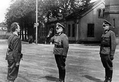 The German garnison's commander Major Josef Nichterlein [no] and his aide Captain Johannes Hamel handing the fortress over to the Norwegian resistance movement's Terje Rollem (May 11, 1945)
