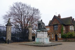 Statue of Robert Gascoyne-Cecil, 3rd Marquess of Salisbury in front of the park gates of Hatfield House.