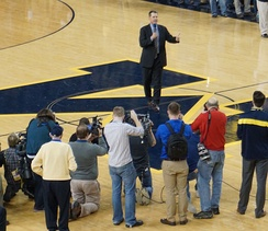 Harbaugh introduced as the head football coach at Michigan during half-time of a men's basketball game