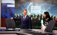 Former Russian President Dmitry Medvedev in the Washington studio of Russia Today TV with Margarita Simonyan