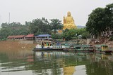 Buddha statue and tour boats at Nui Coc Lake