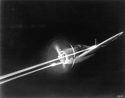 P-47 firing its eight M2 .50 machine guns during night gunnery