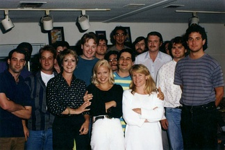 Part of the writing staff of The Simpsons in 1992. Back row, left to right: Mike Mendel, Colin A. B. V. Lewis (partial), Jeff Goldstein, Al Jean (partial), Conan O'Brien, Bill Oakley, Josh Weinstein, Mike Reiss, Ken Tsumura, George Meyer, John Swartzwelder, Jon Vitti (partial), CJ Gibson and David M. Stern. Front row, left to right: Dee Capelli, Lona Williams, and unknown.