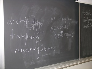 Blackboard used in class at Harvard shows students' efforts at placing the ü and acute accent diacritic used in Spanish orthography.