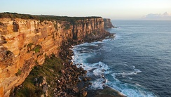 Sydney Heads, a series of headlands which form the 2 km (1.2 mi) wide entrance to Sydney Harbour.