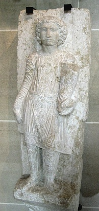 A statue of a young Palmyran in fine Parthian trousers, from a funerary stele at Palmyra, early 3rd century AD
