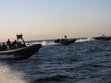 Philippine Navy rigid hull inflatable boats perform a maritime interdiction operation exercise in Manila Bay.