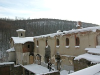Left: Destroyed Serbian Orthodox Holy Trinity Church in Petrić villageRight: Devič monastery after it was burned down in 2004 unrest in Kosovo.