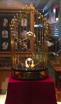 The Commissioner's Trophy given to the Atlanta Braves—owned at the time by Turner—for winning the 1995 World Series (shown on display at Turner Field—named for Turner—the Braves' home ballpark)