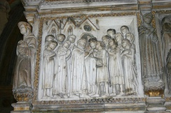 A scene from Peter of Verona's life: a mute man is miraculously healed. Detail from the relief on the back side of Peter of Verona's grave in the Portinari Chapel in Basilica of Sant'Eustorgio in Milan, Italy.