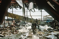 Aftermath of an Iraq Armed Forces strike on US barracks