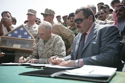 Maj. Gen. John Kelly and Gov. Maamoon Sami Rasheed al-Alwani Governor of Al Anbar sign formal agreement turning security responsibilities of the Al Anbar province to the Government of Iraq. (Sep. 1, 2008)