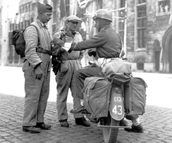 Members of the Belgian Resistance with a Canadian soldier in Bruges, September 1944 during the Battle of the Scheldt