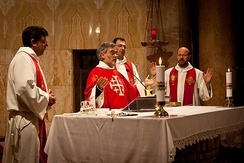 A contemporary Mass in modern practice, as versus populum became the common posture and gesture practised after the council. The priest faces the congregation, while vestments and artwork are less ornate.