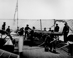 Dahlgren 9-inch smooth bore cannon and crew on the stern pivot position of a Union gunboat