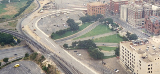A similar view of Dealey Plaza from the mid-1990s also includes the Art Deco Terminal Annex Federal Building in the lower-right foreground, the former Dallas County Courthouse made of red sandstone, and the Dallas County Criminal Courts Building adjacent to the Dallas County Records Building.