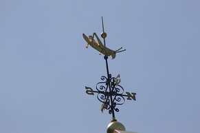 The gilded grasshopper weather vane atop Faneuil Hall
