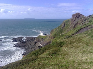 Hartland Point lighthouse. Lundy Island can be seen on the horizon
