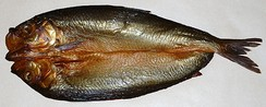 A kipper or split smoked herring