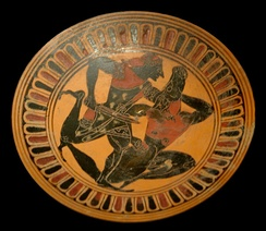 Theseus kills the Minotaur, tondo inside a lip cup by an unknown painter. Ca. 550/540 BC, now in the Louvre, Paris