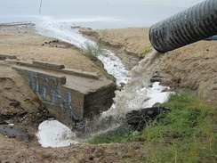 An example of road runoff with fine sediment at El Dorado Beach. However, this storm drain was removed during construction. The new beach now called Lakeview Commons opened in Summer 2012.