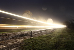 "Freight train passing through Gore, New Zealand. The 'BULB' mode on a DSLR camera was used for this photo. Note the ""flashing"" of the locomotive ditch lights."