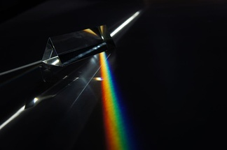 Dispersion of light (photons) by a prism.